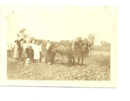 old image of people and horses